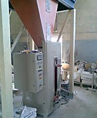 Машина за пакетиране на строителни материа