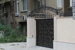 изработка на плътна портална врата от ковано желязо