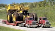 Преместване на огромни строителни машини