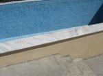 Полагане на облицовки за басейни от мрамор
